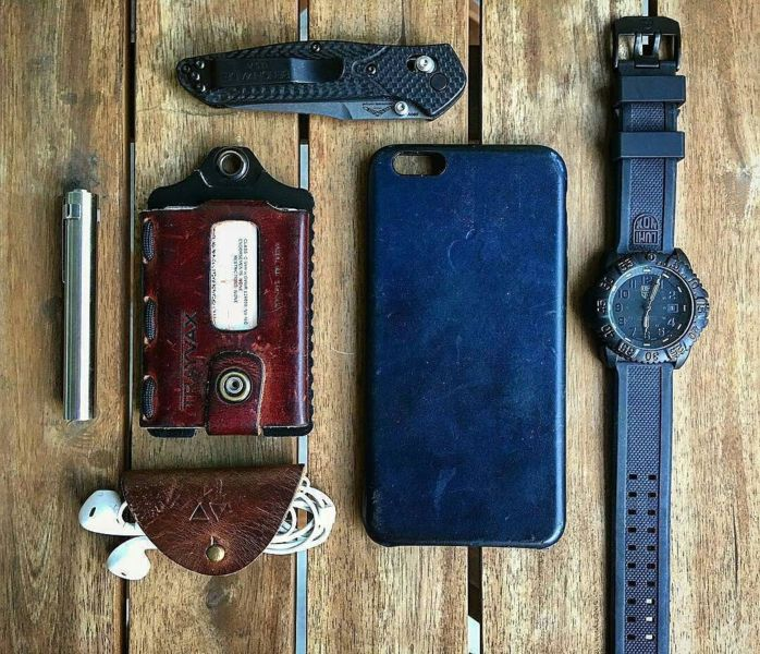 Benchmade - Photo from knives_n_tingz - Monday #PocketDump love the look of worn leather #Benchmade940 #LuminoxWatch #TrayvaxWallet _____________________________________...